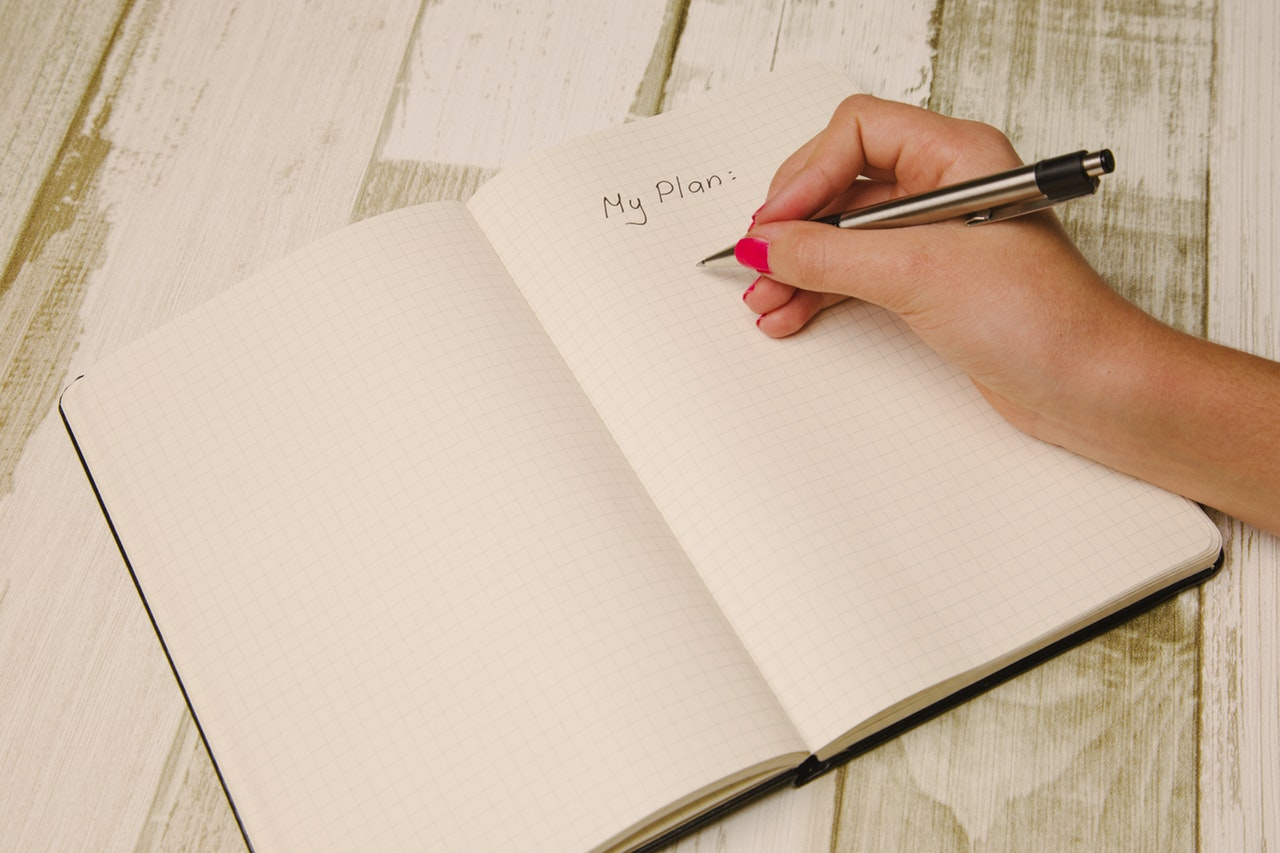 most common interview questions - person writing My Plan: on a notebook