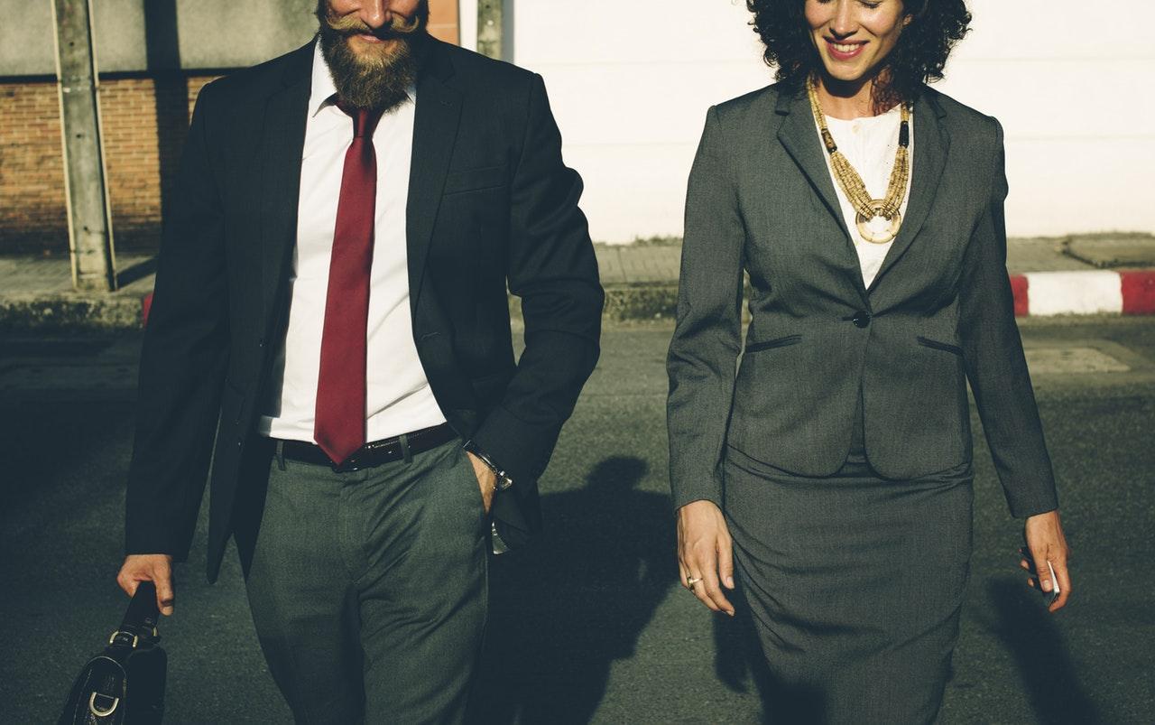 man and women following Singapore work culture dress code